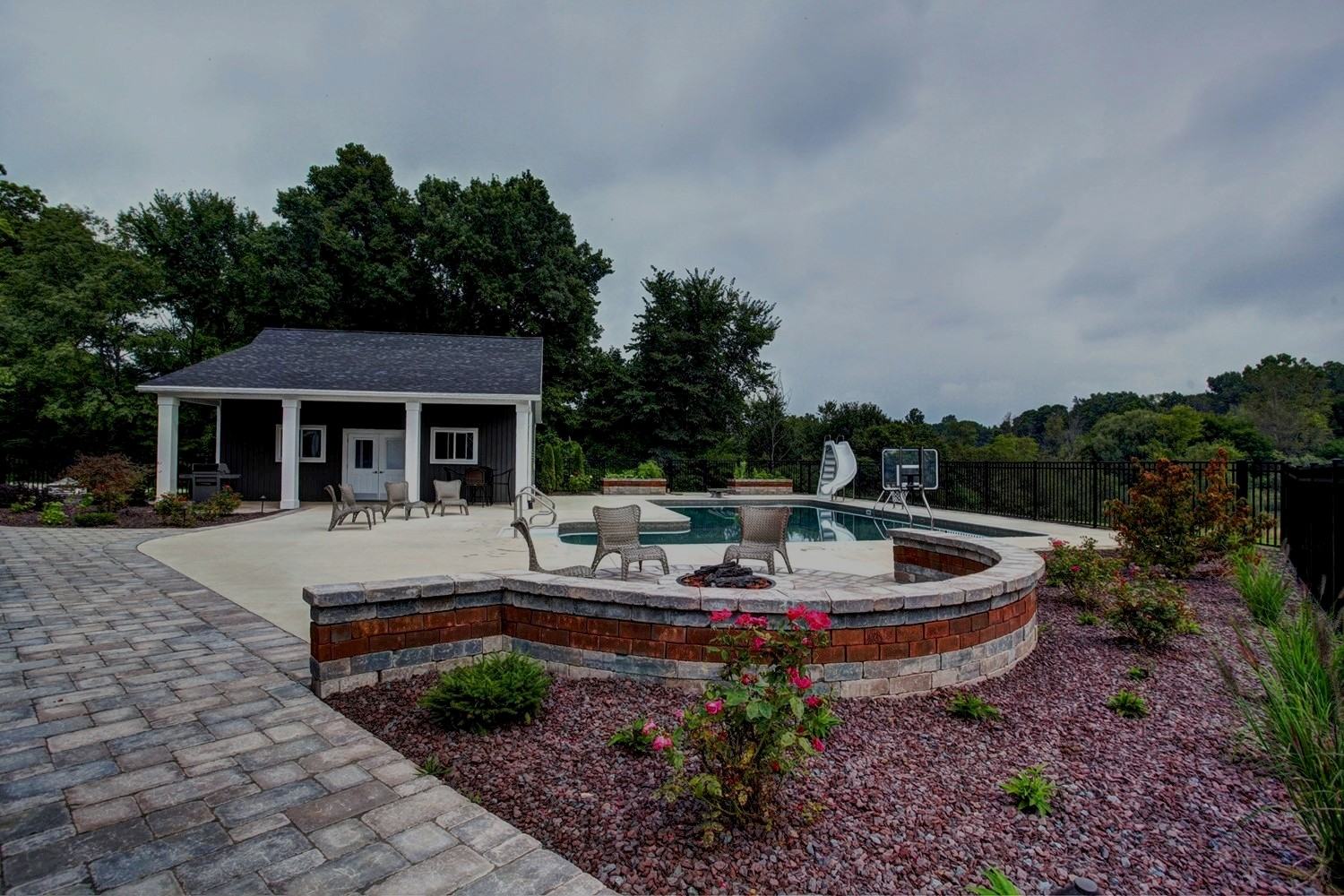 Pool Patio Firepit Construction and Landscaping Services in Grand Rapids MI - ProMowLandscape.com